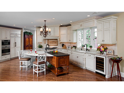 photo of kitchen - partial circle table, 2 chairs white cabinets and ceiling and hardwood floors