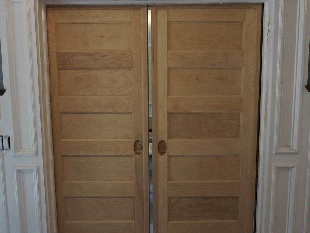 photo of oak panel doors in wall before painting