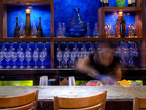 photo of bar with blue venetian plaster bar back
