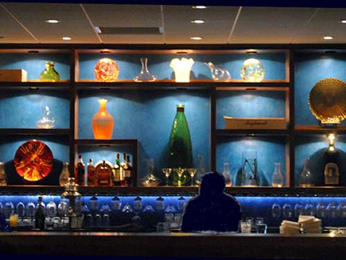 photo of bar with blue venetian plaster wall behind it