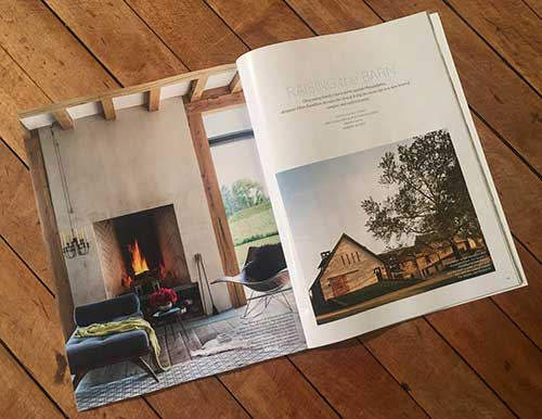 photo of Elle Decor magazine open to article raising the barn