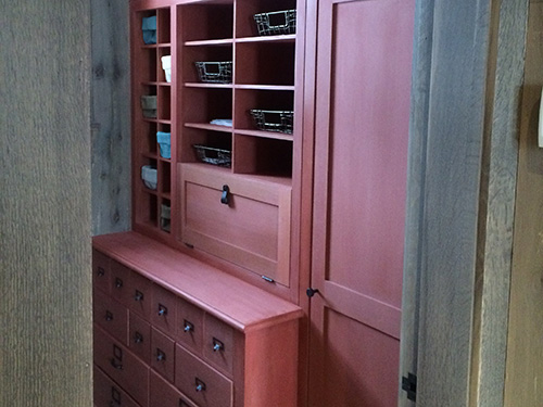photo of cabinets with rust colored milk paint finish
