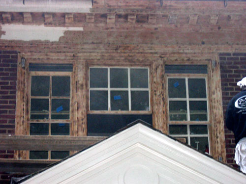 photo of 3 windows and soffit with dentil details