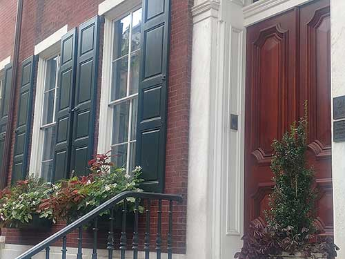 photo of beautifully finished front door on townhome on Delancey Street