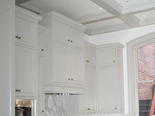 photo of cabinets finished in a bluish white by Old Village