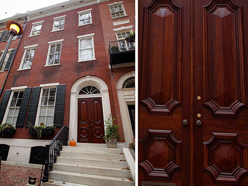 photo of Delancey Place townhome with closeup of stain on door