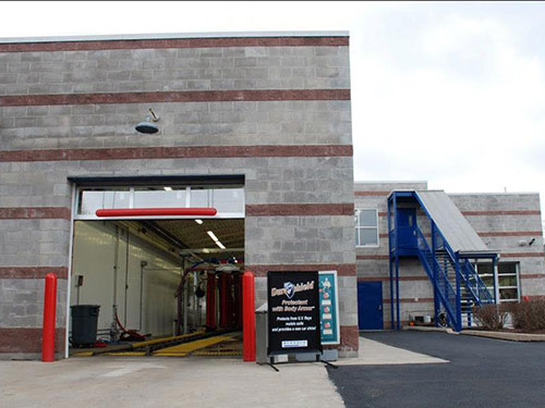 photo of Back Exterior of Car Wash with Blue Stairway