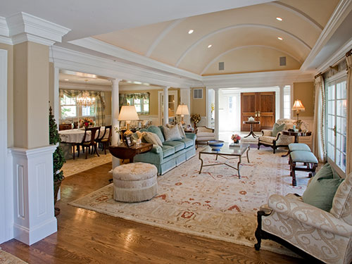 photo of great room with barrel vault ceiling painted light peach,  open to the left to dining room and straight ahead to foyer.