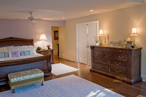 photo of master bedroom with hardwood floors, peach walls and white doors