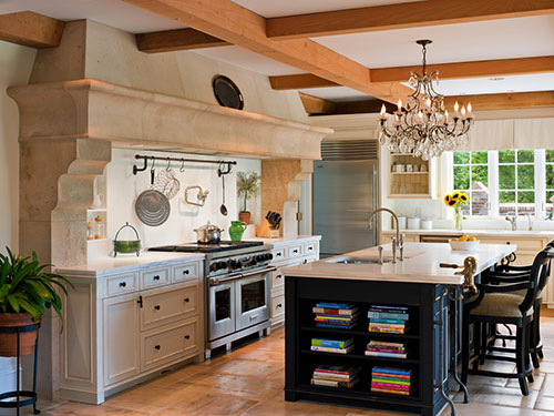 photo of Kitchen featuring yellow ceiling and exposed wood beams