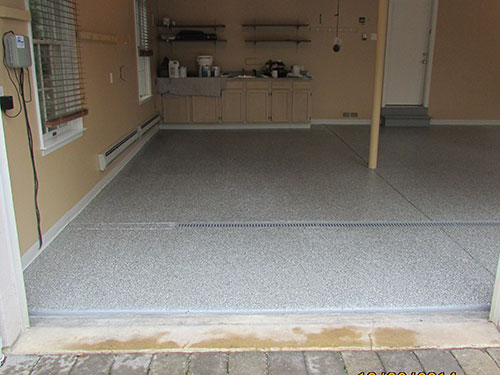 photo of garage bay with new epoxy floor