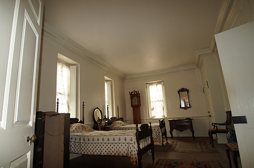 photo of bedroom at Hope Lodge painted white with colonial revival furniture