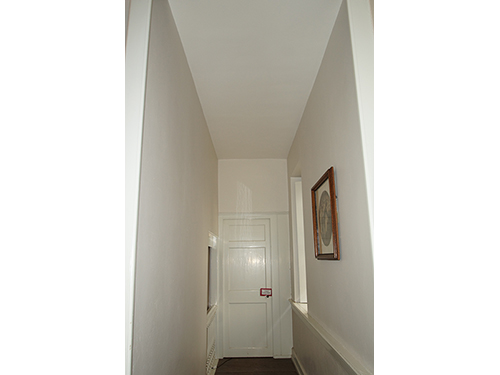 photo of narrow hallway at Hope Lodge painted white by Old Village Master Painters