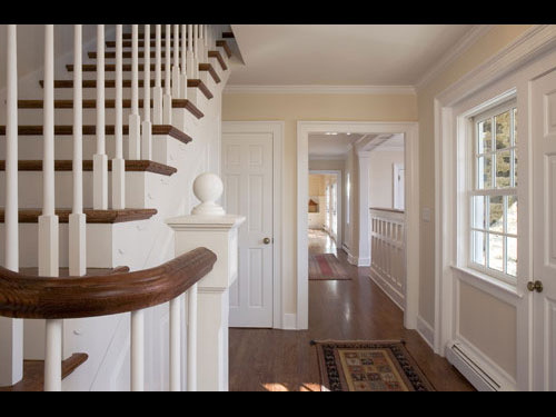 photo of stairrway showing risers, banister, millwork, hallway millwork and wainscotting