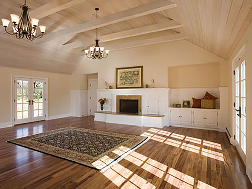 Great Room showing entertainment center cabinetry, pickled wood ceiling, ceiling beams