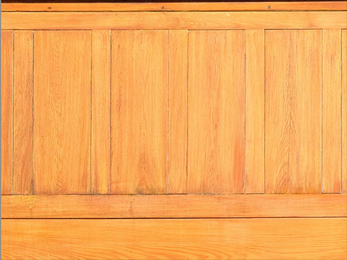 Detail of the cypress paneling on the Korman House after restoration by Old Village
