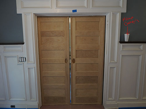 photo of oak pocket doors after removal of lead paint