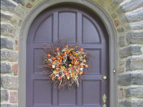photo of Mt Airy Stone Tudor Purple Door with Wreath