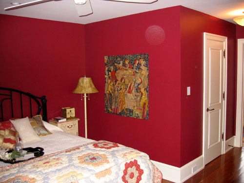 photo of bedroom with red walls and white ceiling