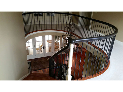 photo of top of staircase highlighting the mahogany handrail