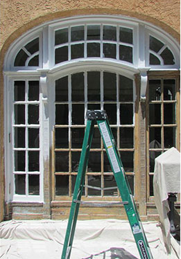 photo of palladium windows in process of having lead paint removed and being restored
