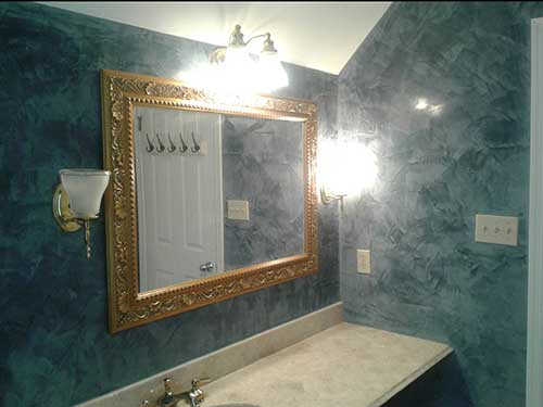 photo of powder room with bluish green venetian plaster walls