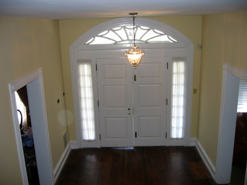 Grand foyer showing doors with detailed window arch