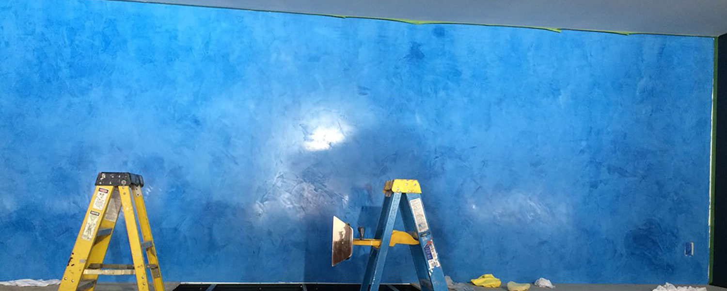 photo of blue venetian plaster wall in progress in Malvern, PA