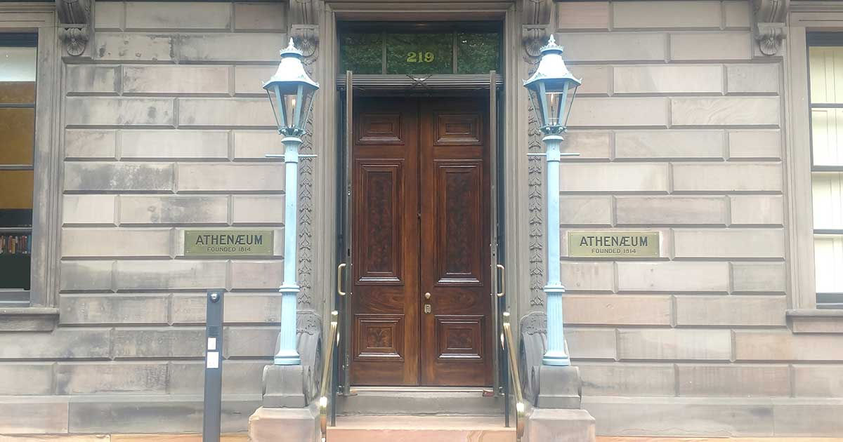 photo of the exterior double oak doors at The Athenaeum in Philadelphia after the doors were restored.