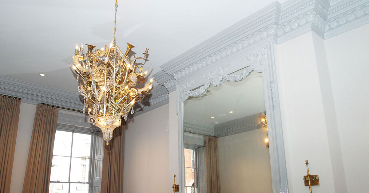 photo of wall, ceiling and crown molding  with chandelier