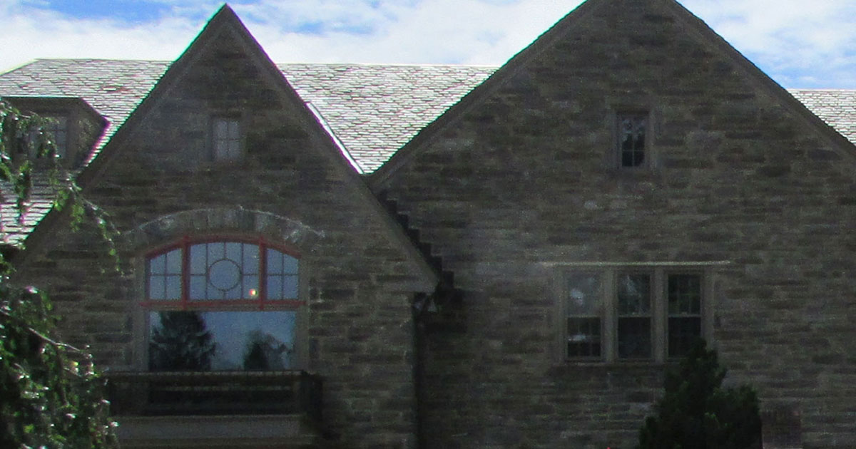 photo of stone home in Bryn Mawr showing windows restored by Old Village Master Painters