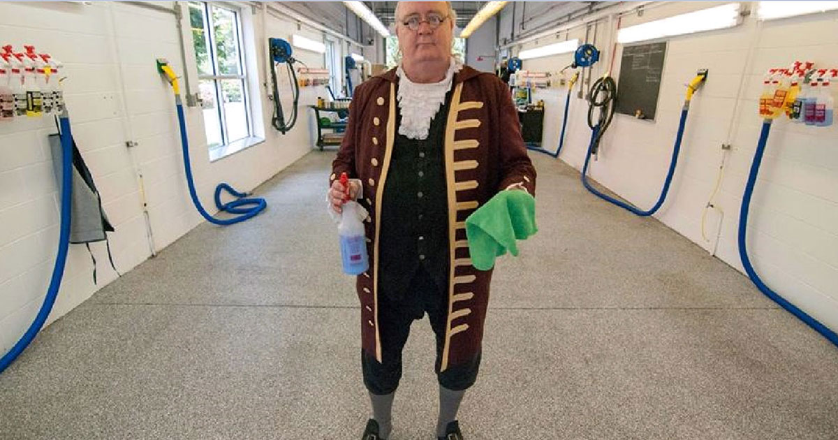 photo of Ben Franklin in Car Wash showing off polymer epoxy floor by Old Village
