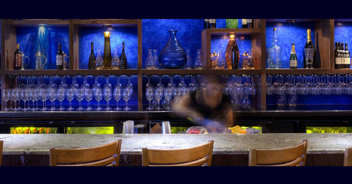 photo bar with blue venetian plaster behind the bar