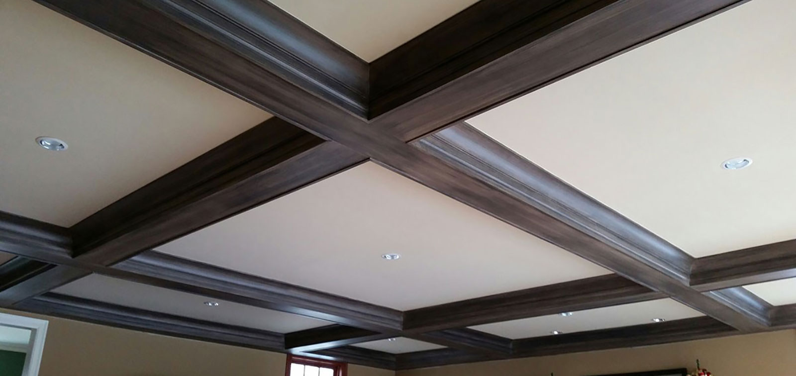 photo of ceiling with stained exposed beams and white coffered ceiling