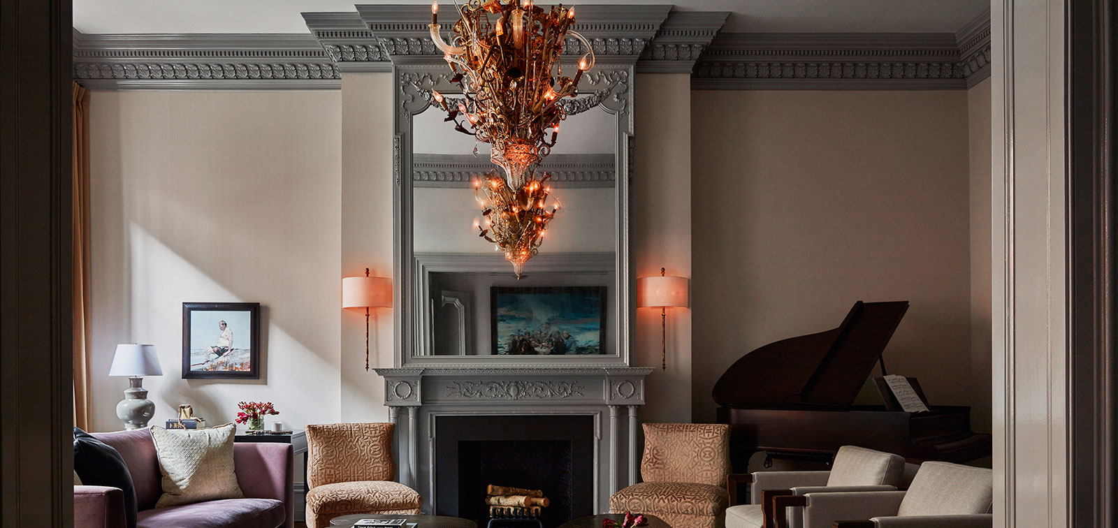 photo of living room with crown moldings, large mirror and center fireplace with mantle all painted in a bluish gray from Fine Paints of Europe