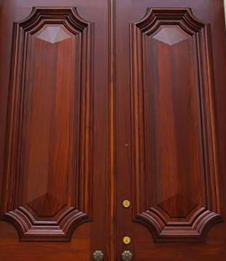 photo showing close up detail of exterior door with a custom chestnut stain from the Old Village Design Studio