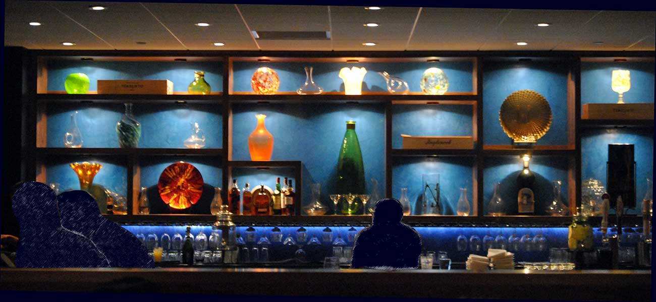 photo of bar with blue venetian plaster wall created by the Old Village Design Studio behind it