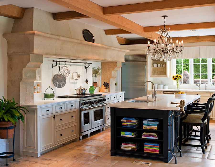 photo of kitchen painted in yellow with center island and exposed beams